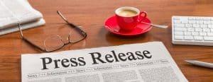 A newspaper on a wooden desk – Press Release